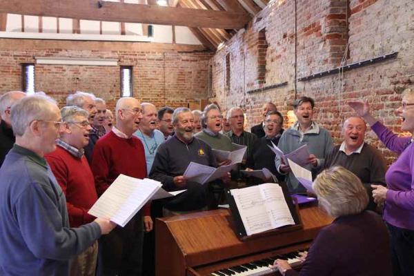 Rehearsal around the piano in Cross Barn
