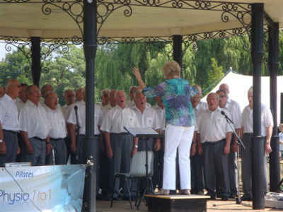 Choir in action on Godalming Bandstand - July 13